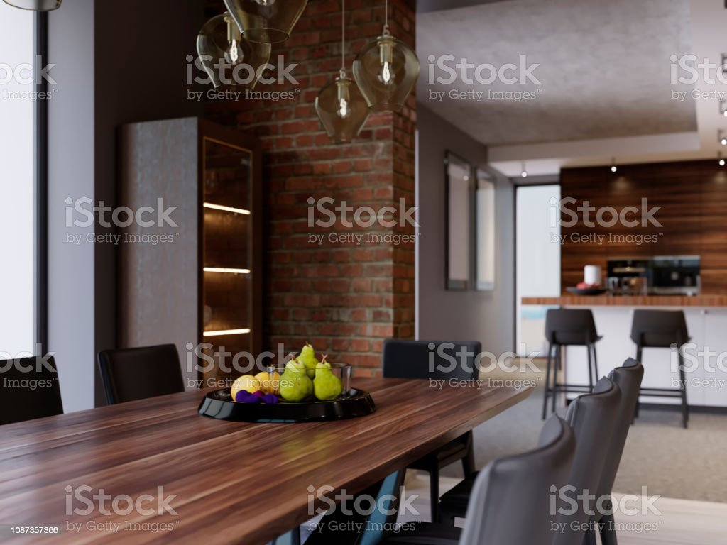 Dining table with decor, black fruit plate. Dining room in modern...