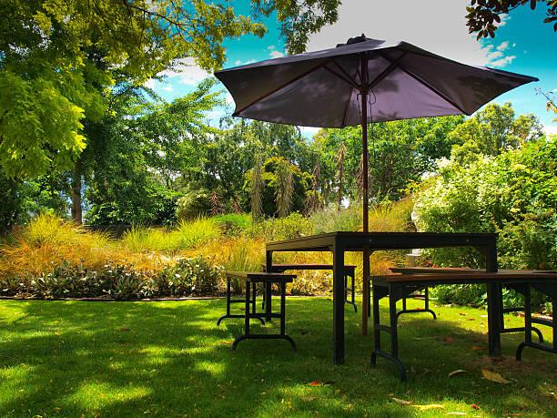 dining table with parasol - sonnenschirm terrasse stock-fotos und bilder