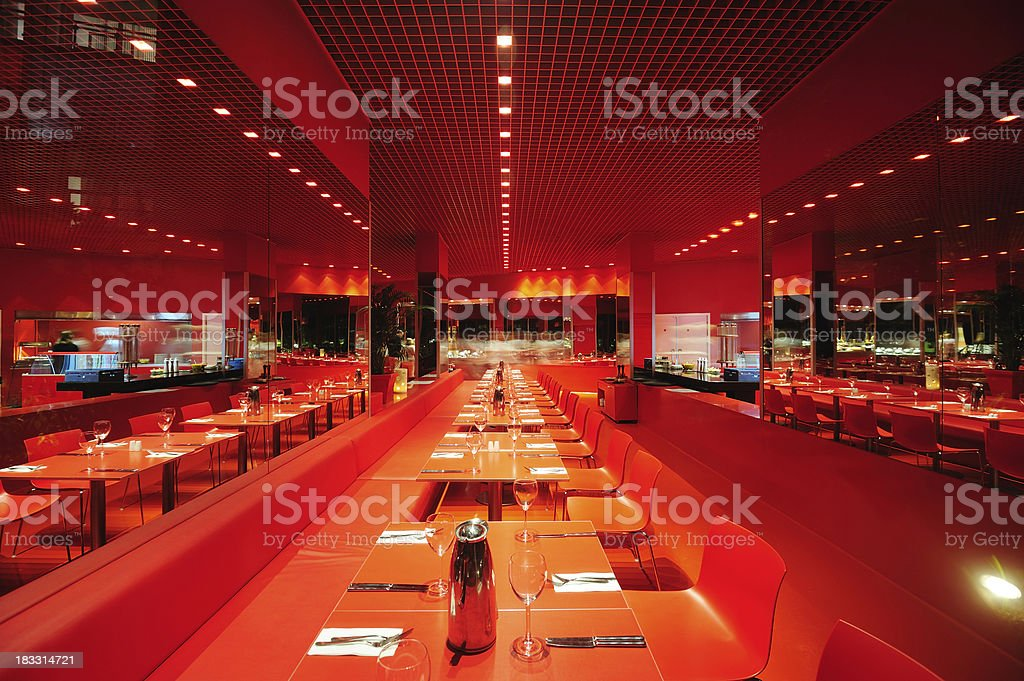 Stylish dining tables in nice restaurant. Blurred people in the...