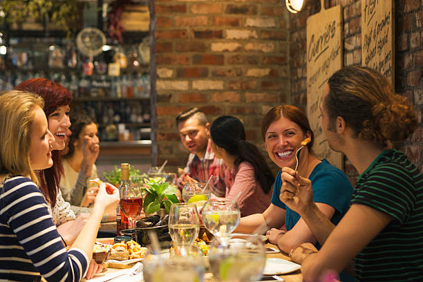Dining with Friends stock photo