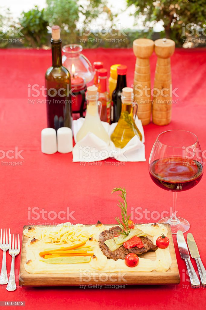 Dinner and steak - wine glass royalty-free stock photo