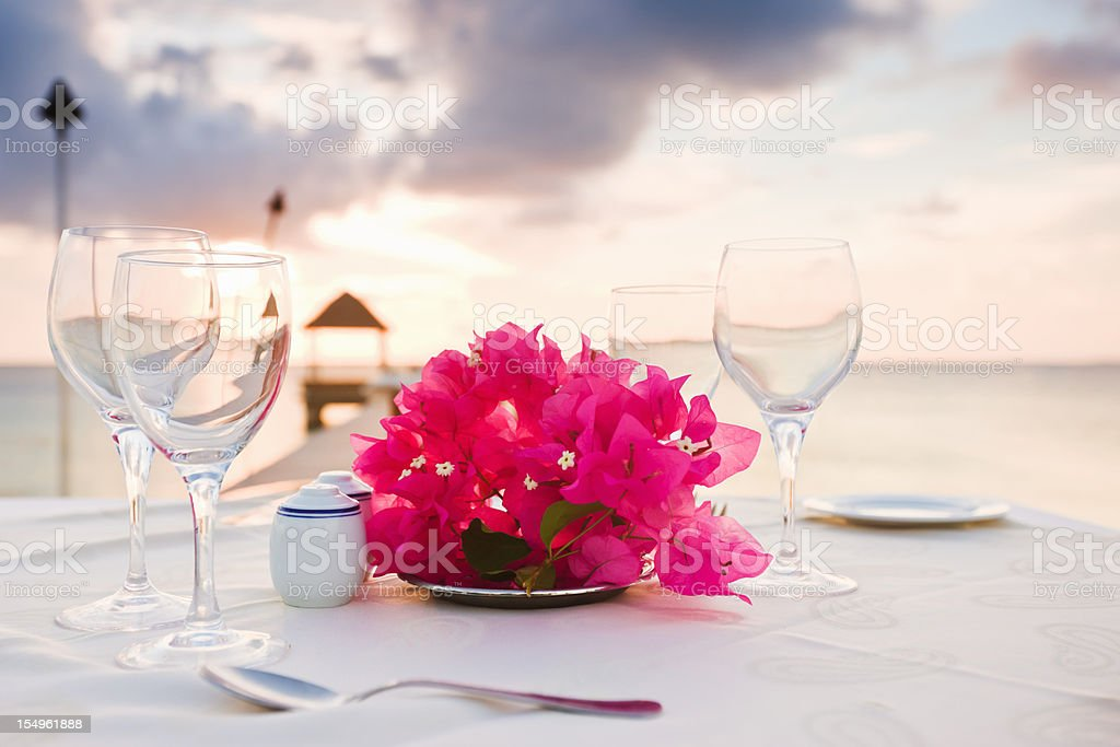 Dinner at the Beach Polynesia Sunset Luxury Holiday Resort stock photo