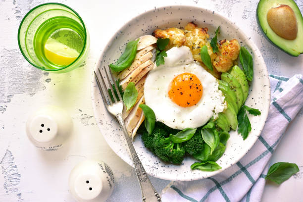 Dinner bowl with meat,fried egg and vegetables stock photo