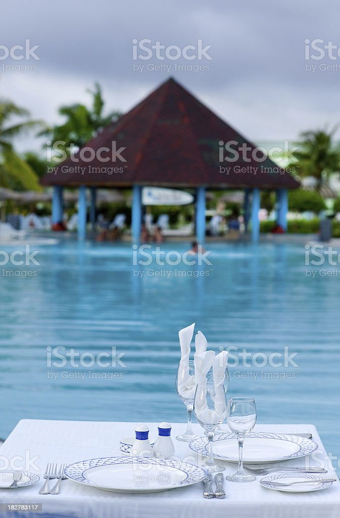 Dinner by the pool royalty-free stock photo