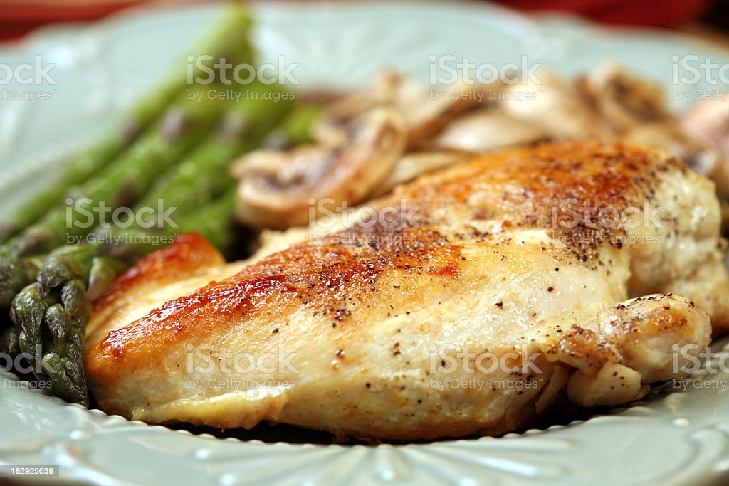 A dinner consisting of chicken, asparagus and mushrooms royalty-free stock photo