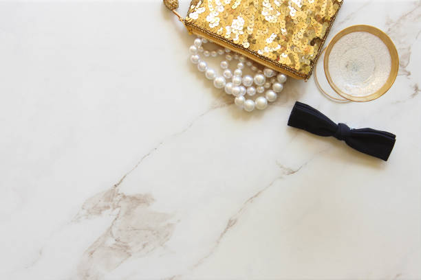 Dinner date Glamorous fashion items and a glass of champagne. White marble copy space. dressing up stock pictures, royalty-free photos & images