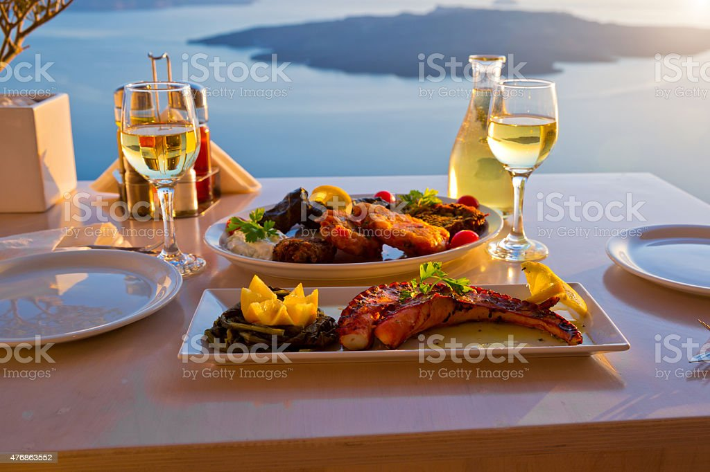Dinner for two and the sea sunset stock photo