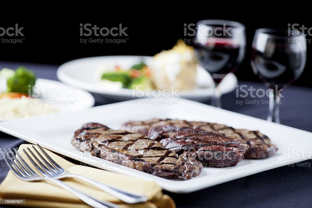 DInner for two: sampler of steaks with sides royalty-free stock photo