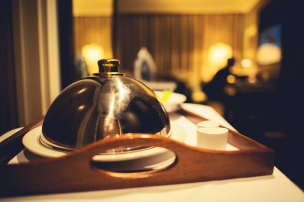 dinner hotel room service - food delivery стоковые фото и изображения