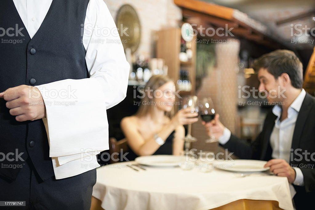 Dinner in a luxury restaurant with wine glasses stock photo