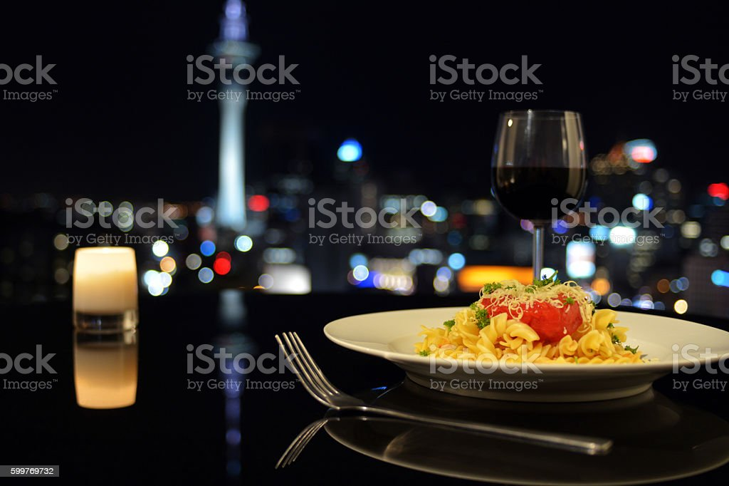Dinner in front of Auckland city skyline at night stock photo