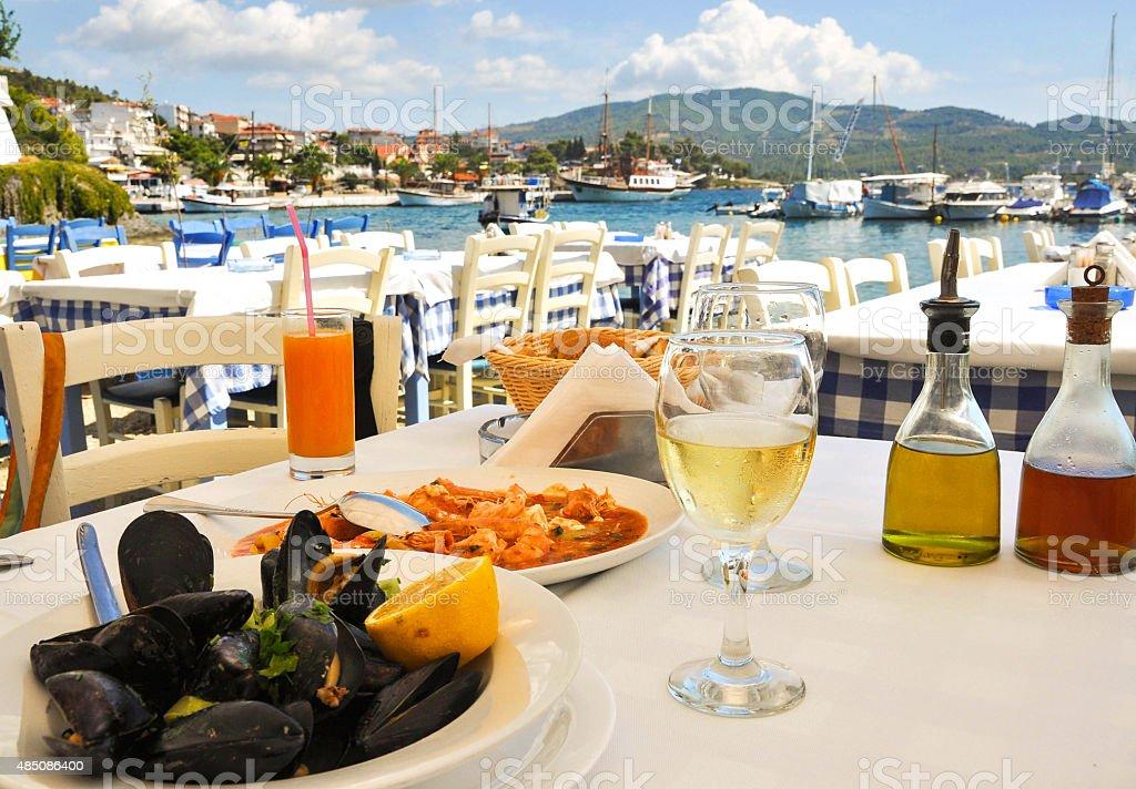 dinner in greece restaurant stock photo