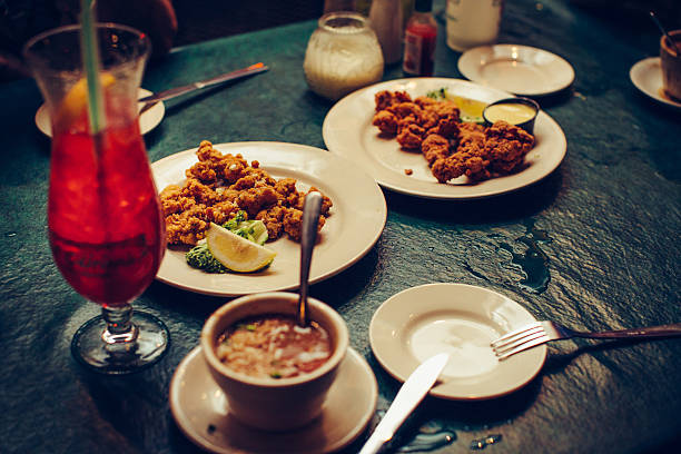 dinner in new orleans - caribbean food stock photos and pictures