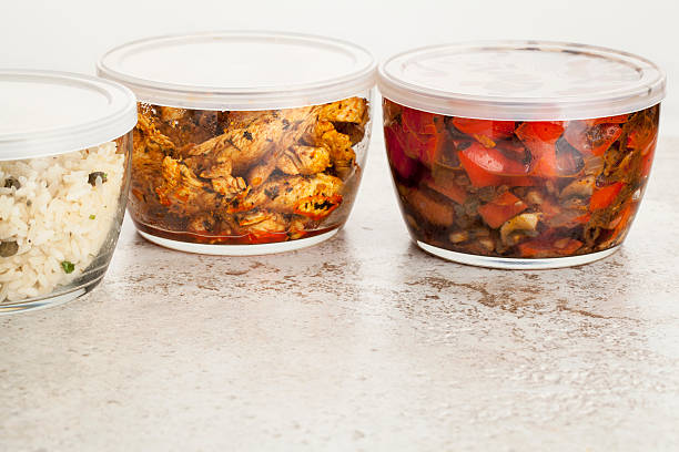 dinner meal in glass containers stir fry dinner meal or leftovers stored in glass containers leftovers stock pictures, royalty-free photos & images