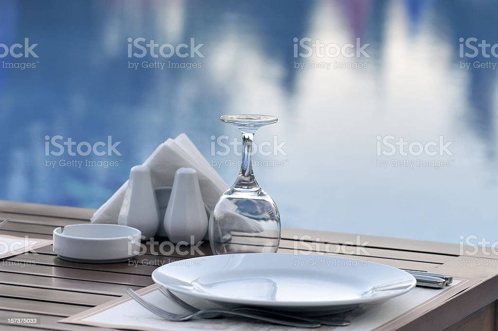 Dinner near the pool royalty-free stock photo