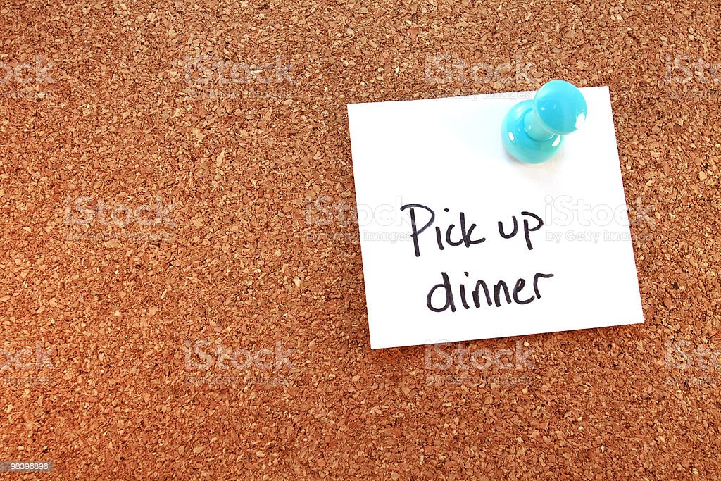 Dinner Note Tacked To Corkboard royalty-free stock photo