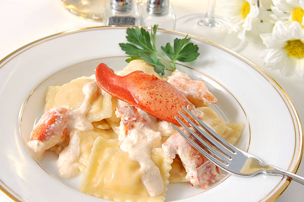 Dinner of tasty lobster ravioli stock photo