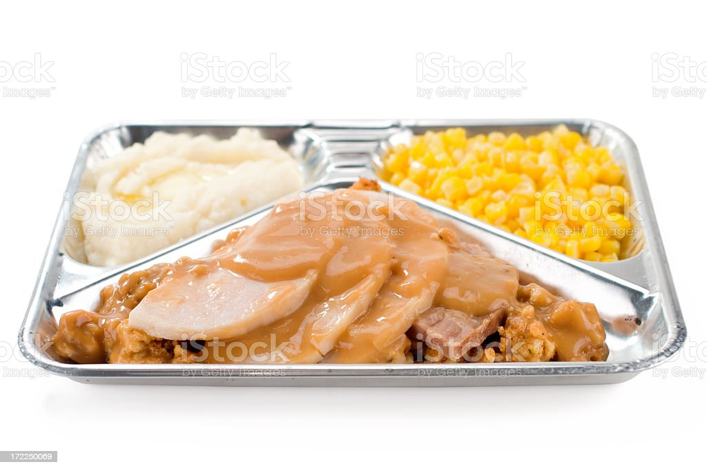 A TV dinner of turkey, sweet corn and mashed potatoes stock photo