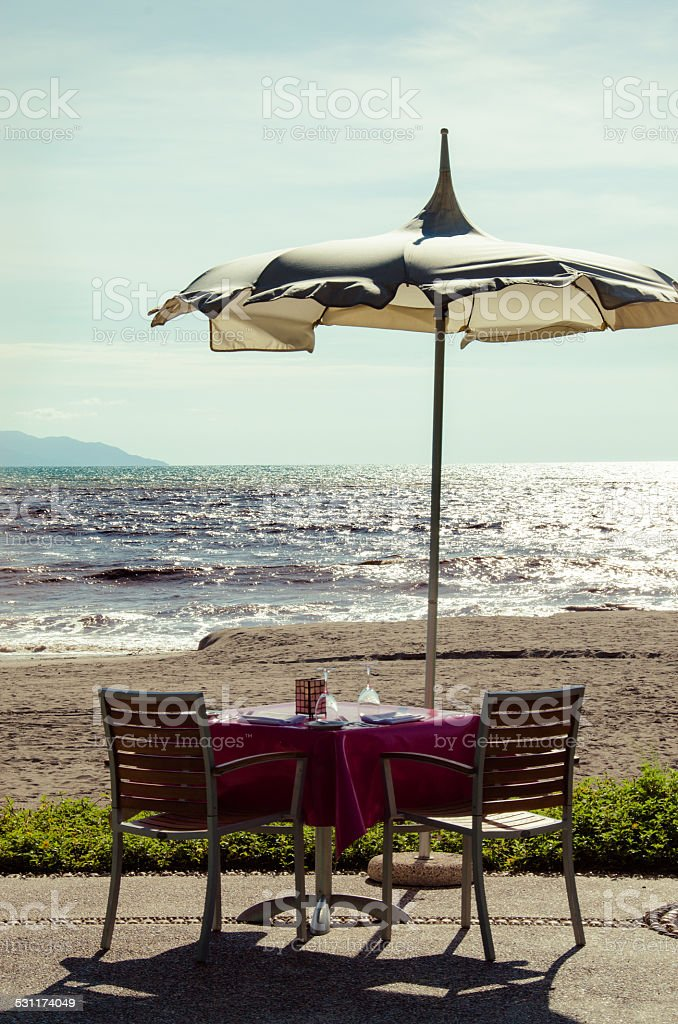 Dinner on the beach- vertical stock photo