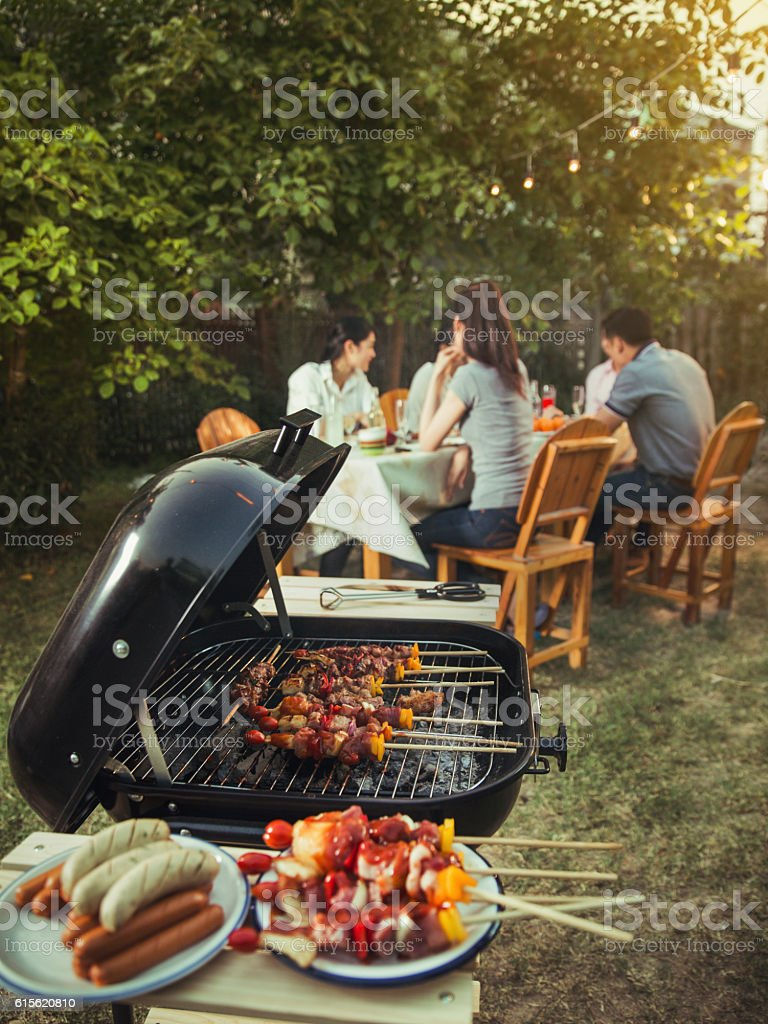 Dinner party, barbecue and roast pork at night - foto de stock