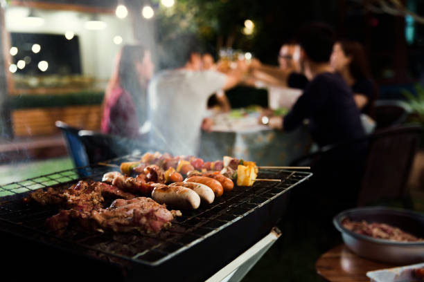 Dinner party, barbecue and roast pork at night Dinner party, barbecue and roast pork at night pavilion stock pictures, royalty-free photos & images