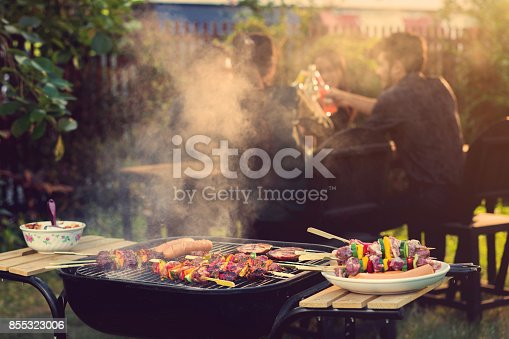 istock Dinner party, barbecue and roast pork at night 855323006