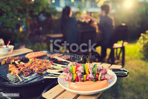 istock Dinner party, barbecue and roast pork at night 855325354