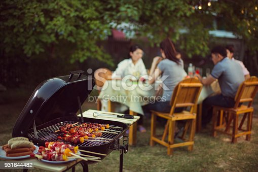 istock Dinner party, barbecue and roast pork at night 931644482