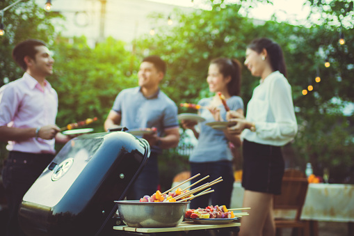 istock Dinner party, barbecue and roast pork at night 931644570
