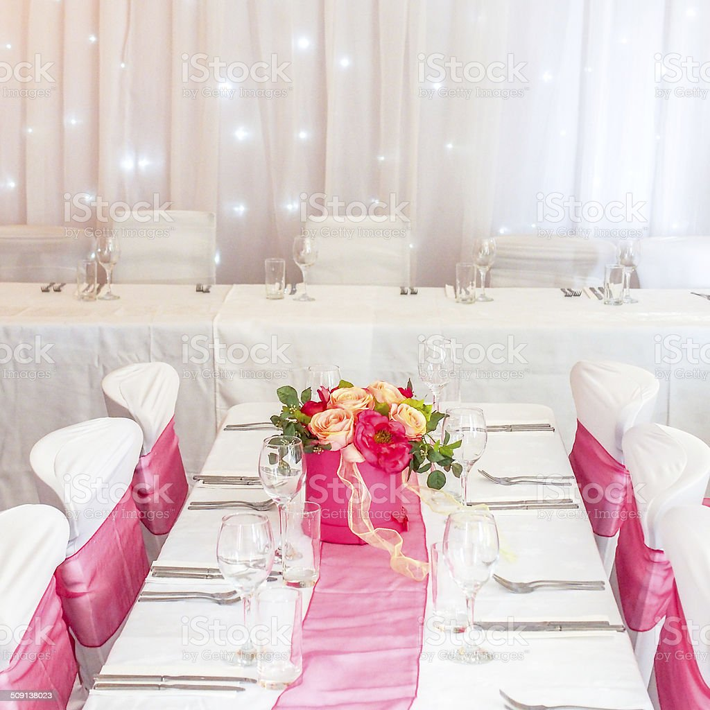 Dinner Party Table With Flowers & Star Curtain stock photo