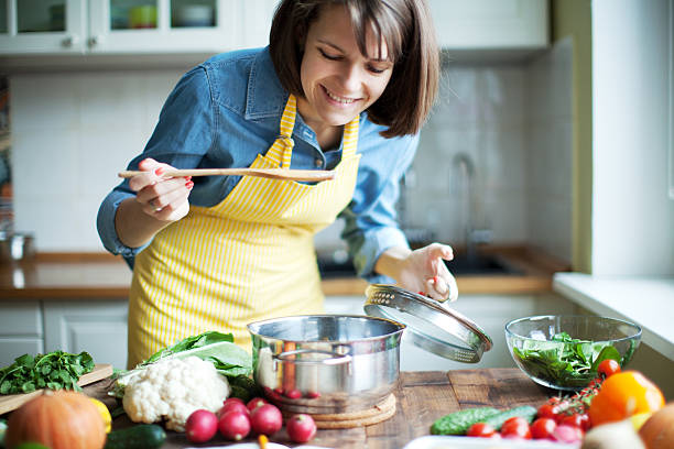 dinner - woman cooking stock pictures, royalty-free photos & images