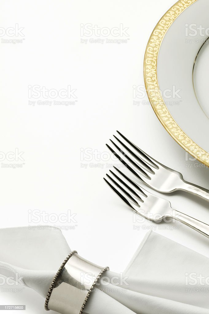 Dinner plate and silverware isolated on white background royalty-free stock photo