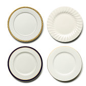 Four elegant dinner plates om white with soft shadow. Place your own food on plate