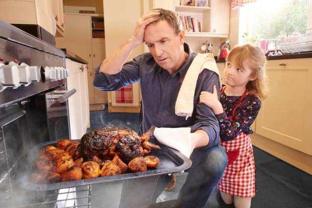 dinner ruined - burned cooking imagens e fotografias de stock