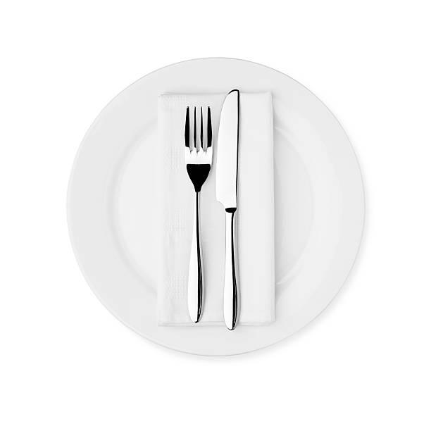 Dinner Setting - White Plate, Knife, Fork and Serviette stock photo