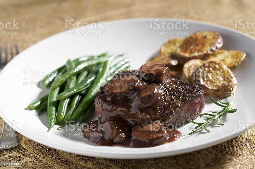 Dinner Steak with Mushroom Wine Sauce and Vegetables, White Plate royalty-free stock photo