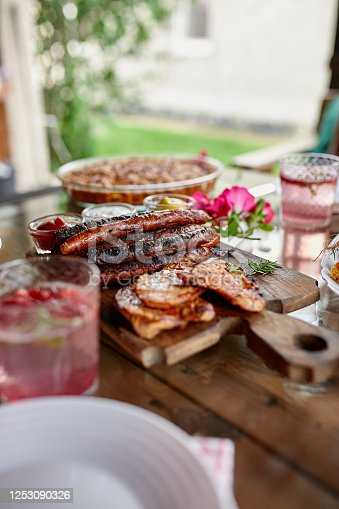 657146780 istock photo Dinner table appetizers variety serving on party outdoor table at home. 1253090326