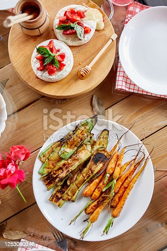 657146780 istock photo Dinner table appetizers variety serving on party outdoor table at home. 1253090346