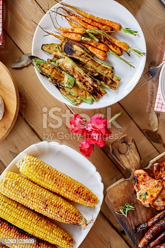 657146780 istock photo Dinner table appetizers variety serving on party outdoor table at home. 1263103609