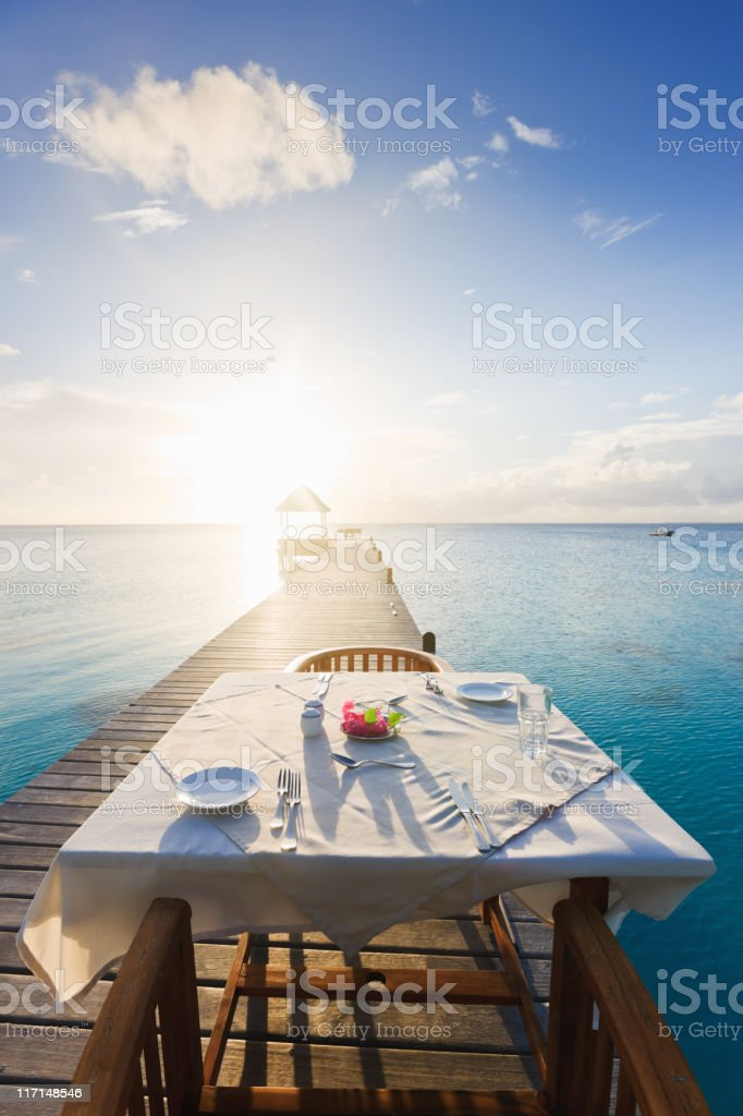 Dinner Table at Sunset Luxury Tourist Resort stock photo