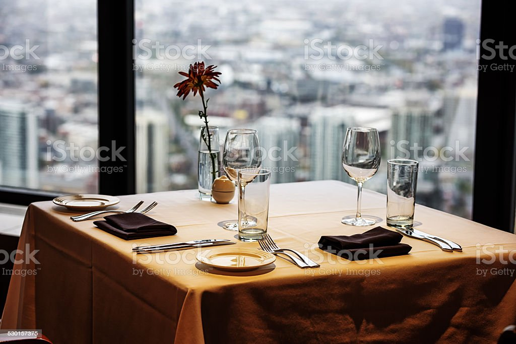 Dinner table for two with skyscraper view stock photo