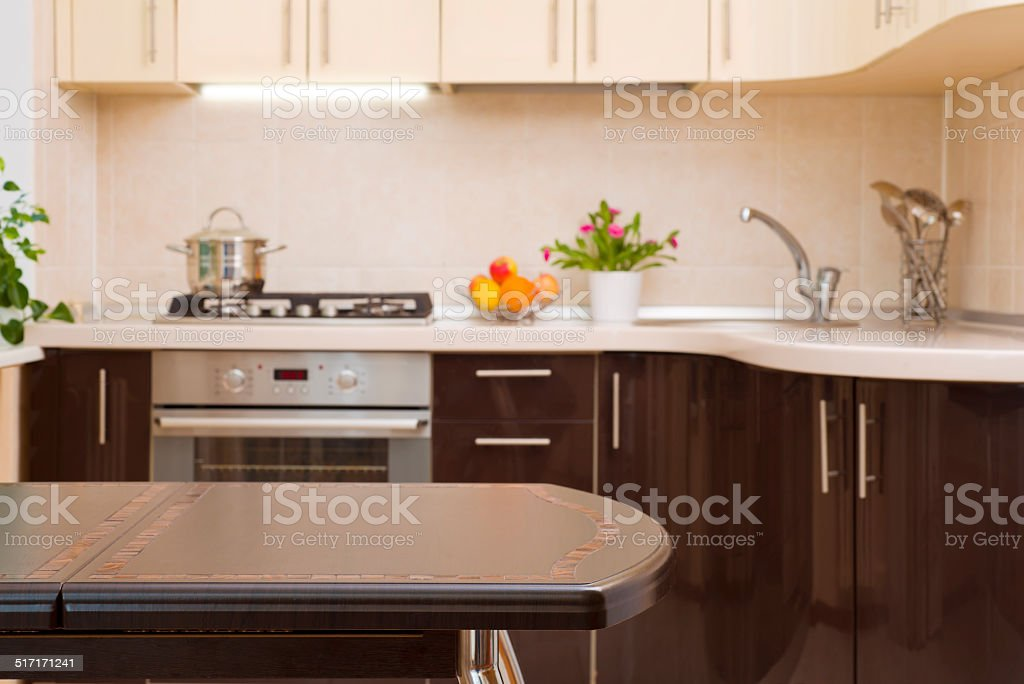 Dinner table on blurred kitchen interior background stock photo