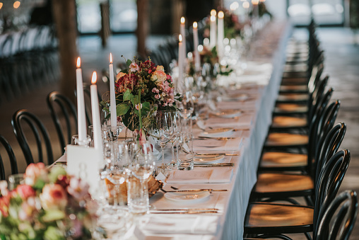 Wedding dinner table with empty glasses