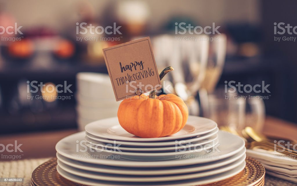 Dinner table preparations for Thanksgiving with greeting stock photo