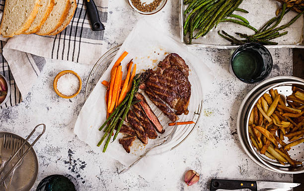 Dinner Table Set With Bbq And Vegetables stock photo