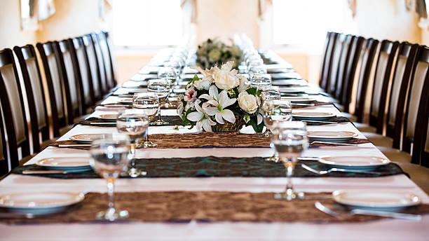 dinner table - wineglass - dining table stock photos and pictures