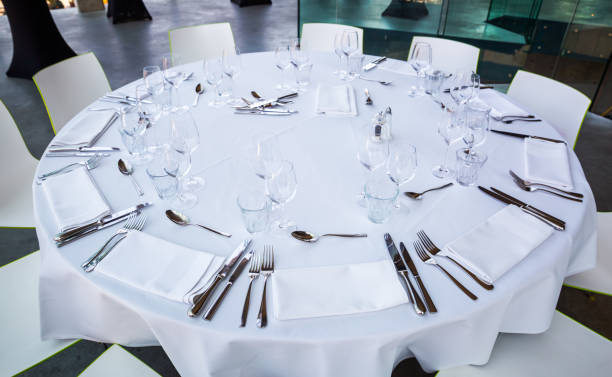 Dinner table with empty glasses and plates stock photo