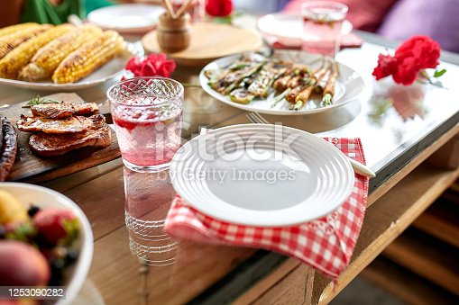 657146780 istock photo Dinner table with meat grill, roast vegetables, sauces and lemonade, variety serving 1253090282