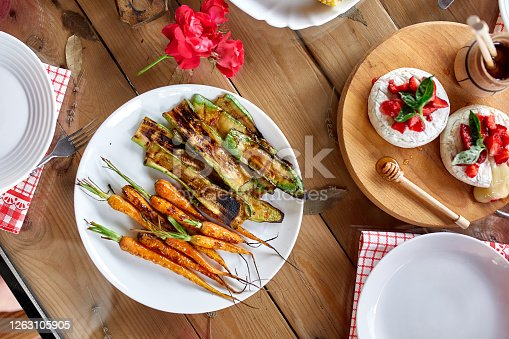 657146780 istock photo Dinner table with meat grill, roast vegetables, sauces and lemonade, variety serving 1263105905