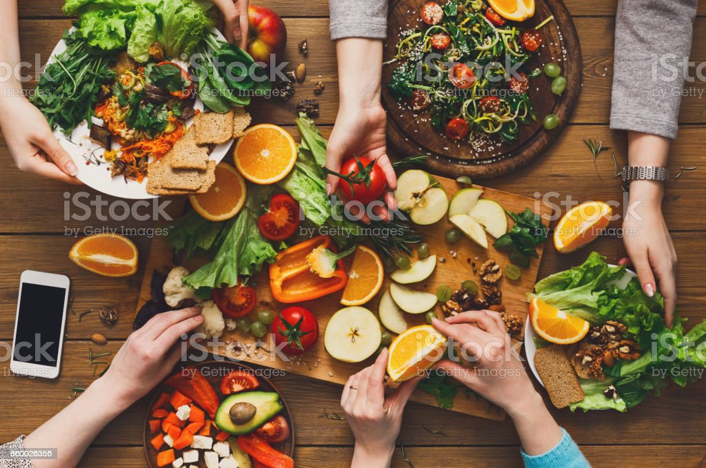 Dinner table, women eat healthy food at home kitchen stock photo